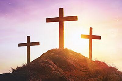 Christian Cross of Jesus Christ at Sunrise