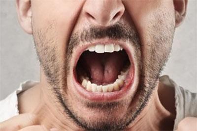 Man mouth close-up shouting